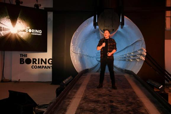 """Tesla Inc. founder Elon Musk speaks at the unveiling event by """"The Boring Company"""" for the test tunnel of a proposed underground transportation network across Los Angeles County, in Hawthorne, California, U.S. December 18, 2018."""