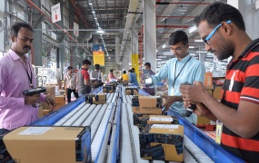 Employees of Amazon India scan packages at Amazon's newly launched fulfilment centre on the outskirts of Bangalore.