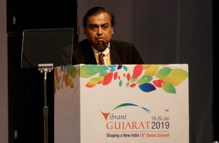 GANDHINAGAR, INDIA - JANUARY 18: Chairman and Managing Director of Reliance Mukesh Ambani speaks at Vibrant Gujarat Global Summit, at Mahatma Mandir Exhibition cum Convention Centre, on January 18, 2019 in Gandhinagar, India. Modi said, We are honoured by the presence of many Heads of State & other distinguished delegates. This shows that international bilateral cooperation is no longer limited to national capitals, but now extends to our state capitals as well. (Photo by )