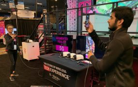 """T-Mobile booth staffers from the University of Washington demonstrate augmented reality over """"5G"""" at the 2019 CES in Las Vegas."""