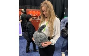 A CES attendee contemplates a new product.
