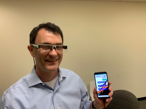 DigiLens CEO Chris Pickett shows off the DigiLens Crystal protoype AR glasses.
