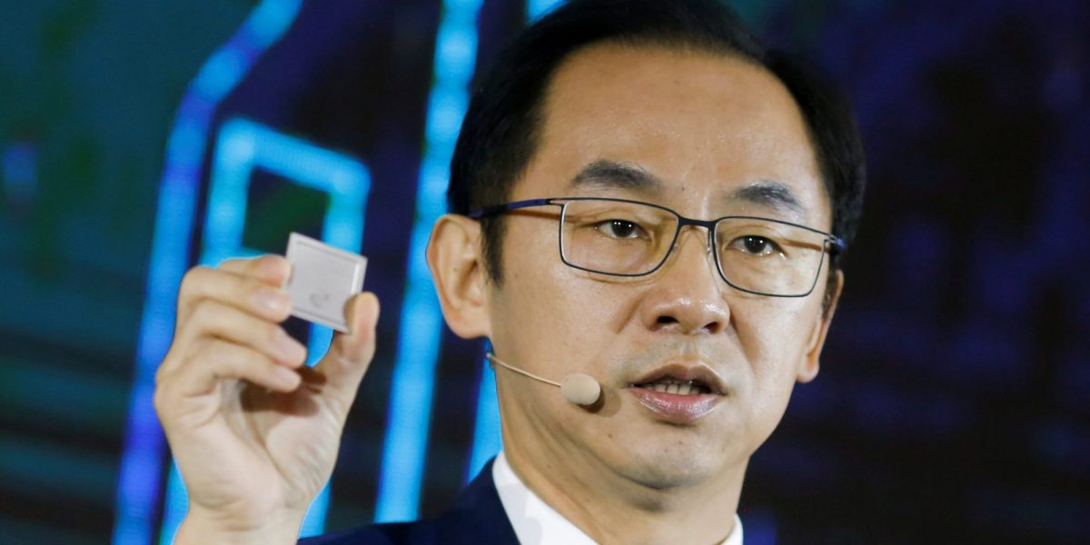 Ryan Ding, the chief of Huawei's carrier business group, holds a Tiangang 5G base station chipset during a product presentation in Beijing, China, January 24, 2019.   REUTERS/Thomas Peter/File Photo
