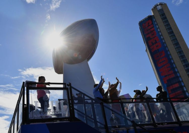 Fans dance during the Super Bowl Experience in Atlanta, Georgia on February 2, 2019. The New England Patriots will meet the Los Angeles Ram at Super Bowl LIII on February 3rd.