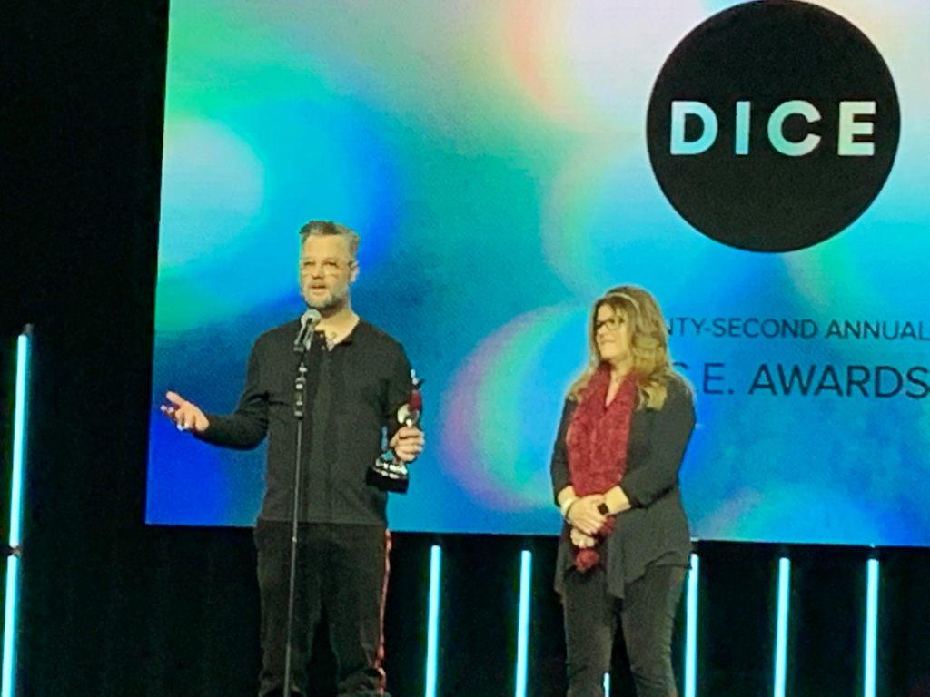 Cory Barlog accepts best story award at DICE Awards for God of War.