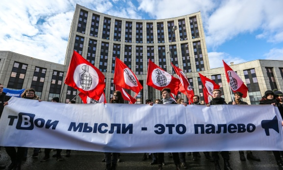 Participants are seen holding a banner and flags during the...MOSCOW, RUSSIA - 2019/03/10: Participants are seen holding a banner and flags during the protest. Participants in an opposition rally in central Moscow protest against tightening state control over the internet in Russia.