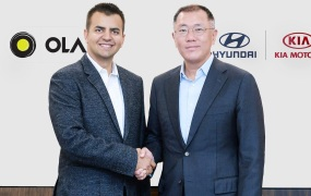 Bhavish Aggarwal, Ola cofounder and CEO, poses with Euisun Chung, Executive Vice Chairman of Hyundai Motor Group.