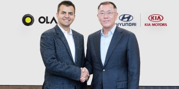 Bhavish Aggarwal, Ola cofounder and CEO, poses with Euisun Chung, Executive Vice Chairman of Hyundai Motor Group.