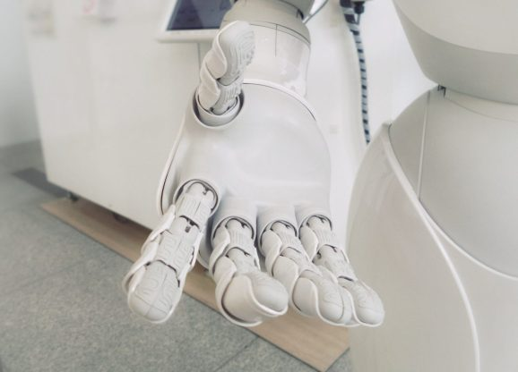 The extended hand of a humanoid robot