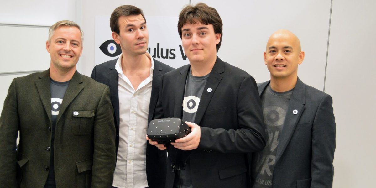 Oculus leaders. Palmer Luckey holds a Rift in his hands.