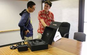 Palmer Luckey (right) delivers the first Oculus Rift.