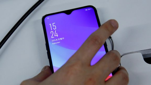 A staffer holds a smart phone being tested for Rakuten's mobile network at its facility in Tokyo, Japan, February 20, 2019.