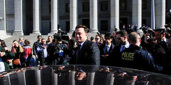 Tesla Inc. CEO Elon Musk (C) exits after attending a S.E.C. hearing at the Manhattan Federal Courthouse