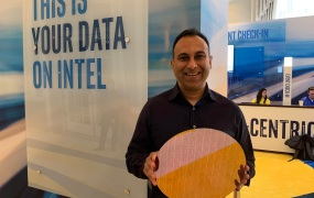 Navin Shenoy, executive vice president at Intel, shows off wafer with latest Xeon Scalable chips.