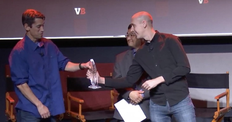 Spencer Tucker of Scopely gives the GamesBeat Visionary Award to Ted Price, CEO of Insomniac Games.
