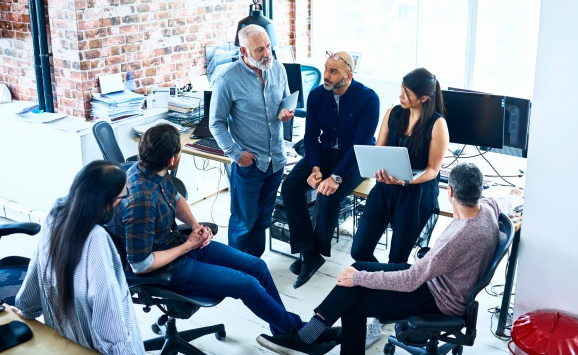 Team of creative people having meeting modern office