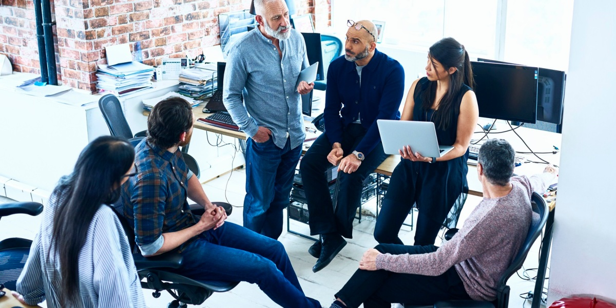 Team of creative people having meeting modern office