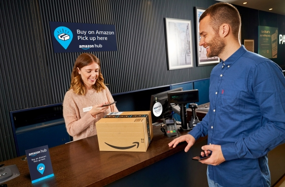 Amazon customer collecting a purchase in a Next retail store.