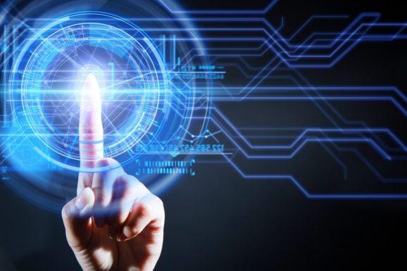 Woman's index finger touching a digital scanner and scanning her fingerprint.