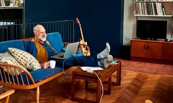 Remote working: Man on sofa... working.