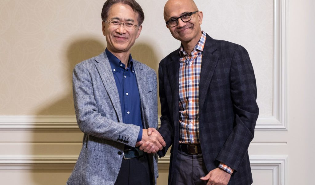 Sony CEO Kenichiro Yoshida (left) shakes hands with Microsoft CEO Satya Nadella.