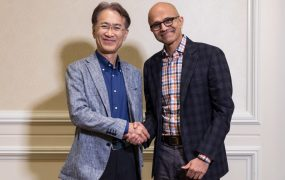 Sony CEO Kenichiro Yoshida (left) shakes hands with Microsoft CEO Satya Nadella.