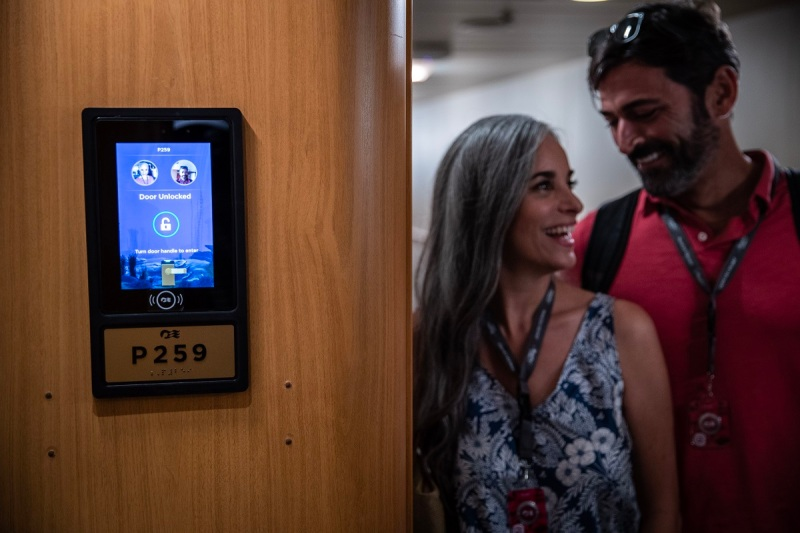Your wearable unlocks the door on the Carnival Royal Princess cruise ship.