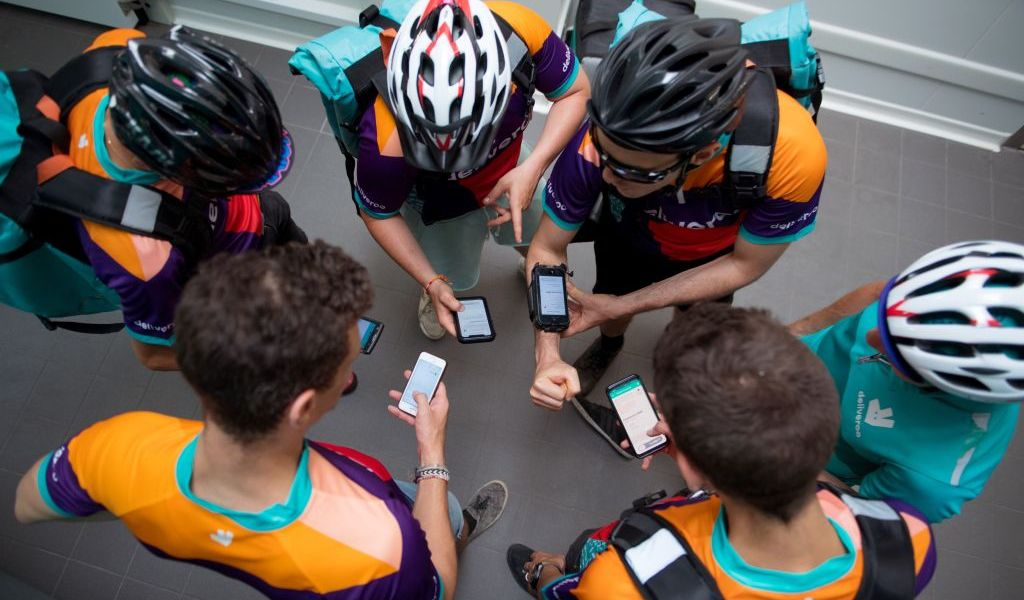 Bikers working for Deliveroo wait for their instructions at one of the first Deliveroo Editions in France kitchens on July 3, 2018.