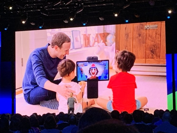 Mark Zuckerberg uses Portal to show an AR app to his kids. His mother is reading them a bedtime story.