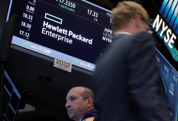 FILE PHOTO: A trader passes by the post where Hewlett Packard Enterprise Co., is traded on the floor of the New York Stock Exchange (NYSE) in New York City, U.S., May 25, 2016.