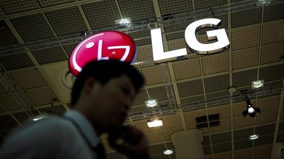 A man talking on his phone walks past the logo of LG Electronics during Korea Electronics Show 2016 in Seoul, South Korea, October 27, 2016.  REUTERS/Kim Hong-Ji/File Photo
