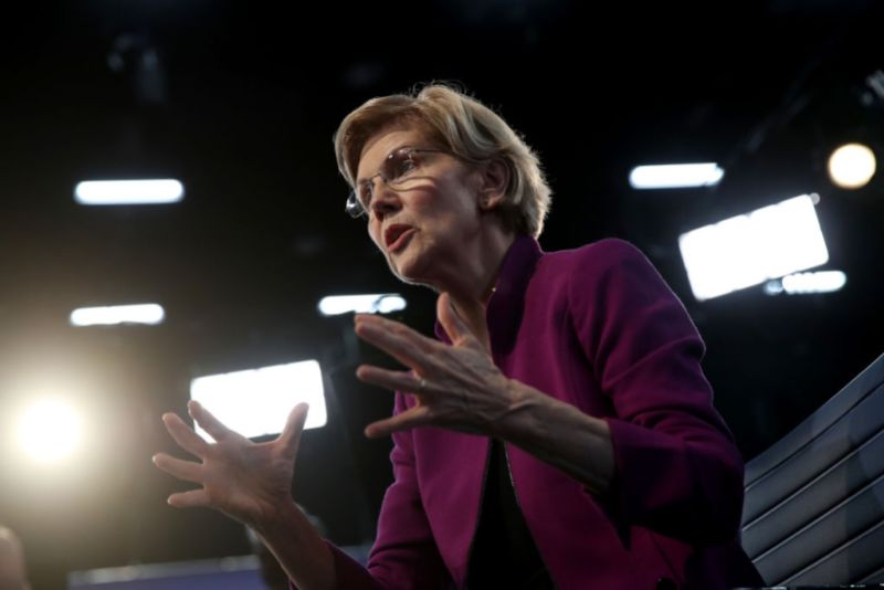 MIAMI, FLORIDA - JUNE 26: Sen. Elizabeth Warren (D-MA) speaks to the media in the spin room following the first night of the Democratic presidential debate on June 26, 2019 in Miami, Florida. A field of 20 Democratic presidential candidates was split into two groups of 10 for the first debate of the 2020 election, taking place over two nights at Knight Concert Hall of the Adrienne Arsht Center for the Performing Arts of Miami-Dade County, hosted by NBC News, MSNBC, and Telemundo.