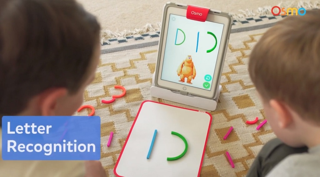 Osmo can recognize letters that children create on a pad.