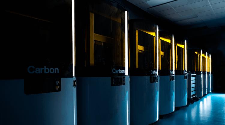 "Row of Carbon L1 ""printers"""