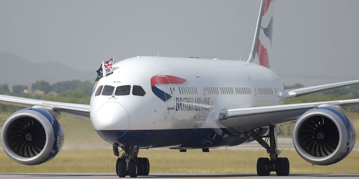 A British Airways aircraft taxies on a runway with the Pakistani (L) and Union Jack flags upon landing at the Islamabad International Airport on the outskirts of Islamabad on June 3, 2019