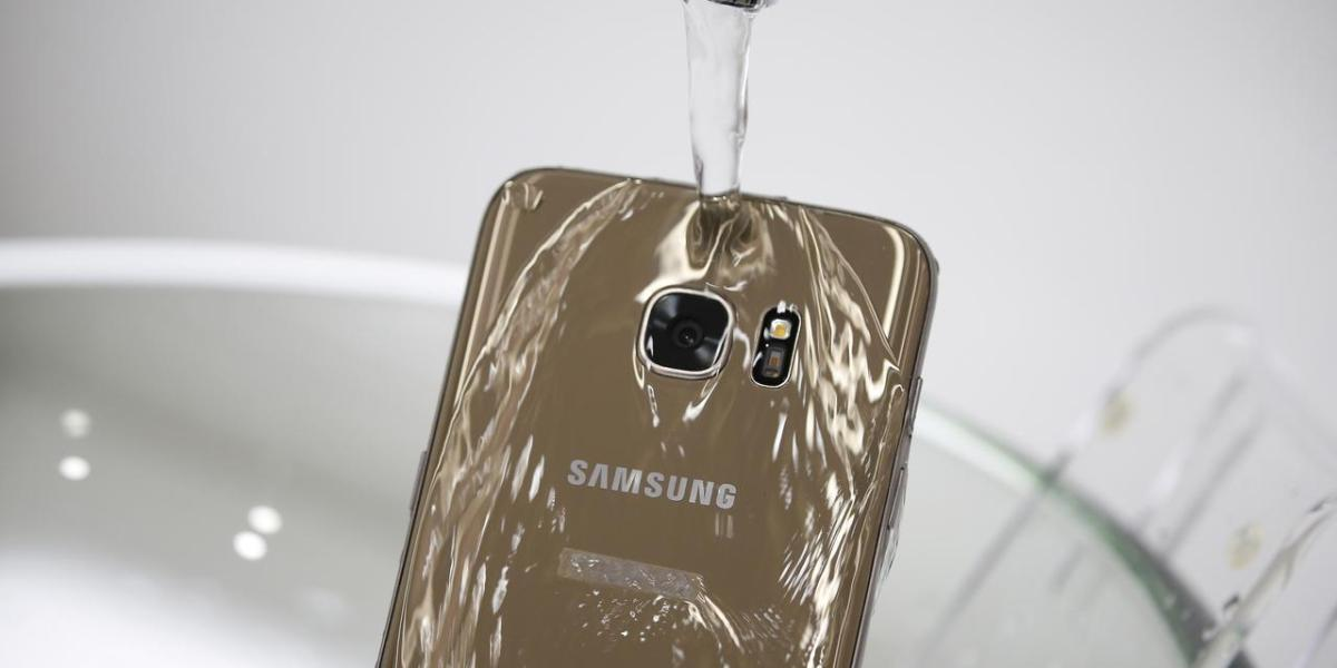 A model demonstrates the waterproof function of Samsung Electronics' new smartphone, Galaxy S7 Edge, during its launch ceremony in Seoul, South Korea, March 10, 2016.