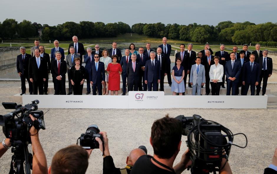 "FintechJuly 18, 2019 / 7:34 AM / Updated 15 hours ago G7 urges tough Libra regulation, agrees to tax digital giants Leika Kihara, David Lawder 4 Min Read CHANTILLY, France (Reuters) - Digital currencies such as Facebook's planned Libra raise serious concerns and must be regulated as tightly as possible to ensure they do not upset the world's financial system, Group of Seven finance ministers and central bankers said on Thursday. Finance Minister Bruno Le Maire of France, which holds the rotating presidency of the G7 top world economies, told a news conference the group opposed the idea that companies could have the same privilege as nations in creating means of payment - but without the control and obligations that go with it. Related Coverage Stablecoins like Libra must be held to highest standards: G7 G7 finance chiefs agree to tackle digital tax challenges: summary ""We cannot accept private companies issuing their own currencies without democratic control,"" Le Maire said. In a summary of the informal G7 talks in Chantilly, north of Paris, the French presidency said the ministers and governors had agreed that ""stablecoins and other various new products currently being developed, including projects with global and potentially systemic footprint such as Libra, raise serious regulatory and systemic concerns"". Governments are starting to worry that big tech companies are encroaching on areas that belong to governments, such as issuing currency. Facebook's June 18 announcement of Libra heralded an effort to expand beyond social networking and move into e-commerce and global payments. The G7 are concerned that Facebook's ambitions for a digital currency might not only weaken their control over monetary and banking policies but also pose security risks. ""A global stablecoin for retail purposes could provide for faster and cheaper remittances, spur competition for payments and thus lower costs, and support greater financial inclusion,"" European Central Bank board member Benoit Coeure, the chairman of the taskforce, told the G7 meeting. G7 finance ministers and central bank governors pose for a family photo, during the G7 finance ministers and central bank governors meeting in Chantilly, near Paris, France, July 17, 2019."