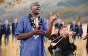 """The BYU Men's Chorus and Philharmonic performing """"Baba Yetu."""""""
