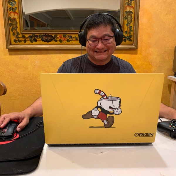 Dean Takahashi plays on a Origin PC laptop.