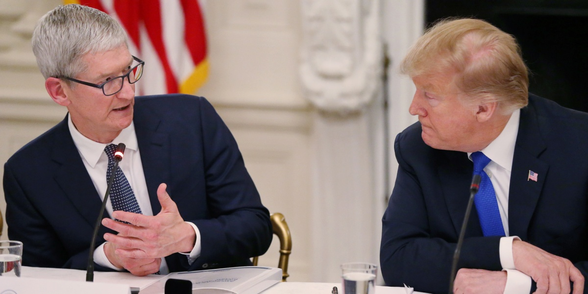 Apple CEO Tim Cook talks with U.S. President Donald Trump