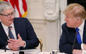 Apple CEO Tim Cook talks with U.S. President Donald Trump