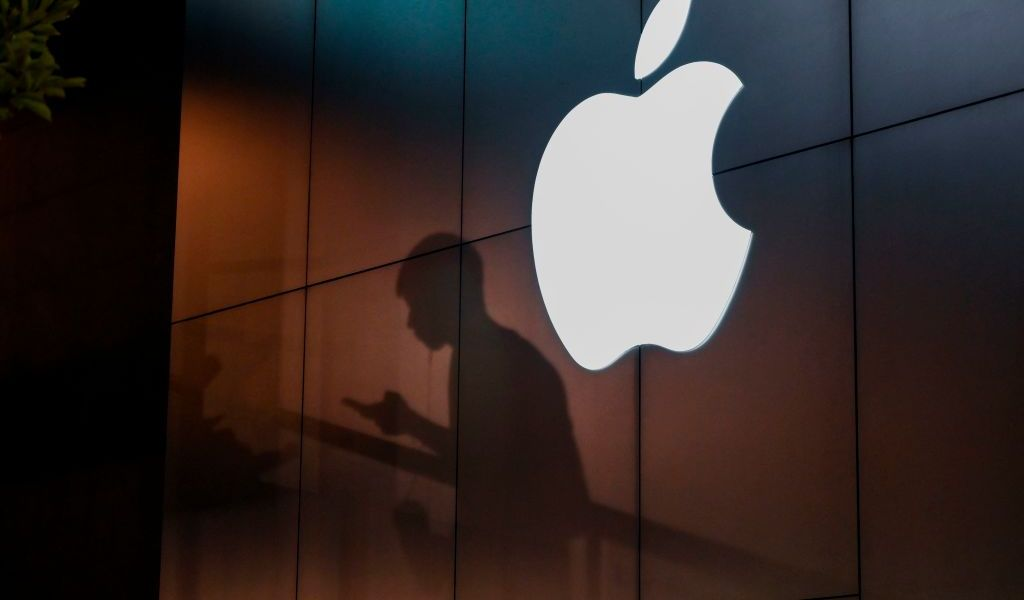 "The shadow of a man is cast on the wall of an Apple store as he uses his mobile phone in Beijing on August 26, 2019. - There were signs of a thaw in frosty trade-war tensions between China and the US on August 26 as President Donald Trump said delegations would ""very shortly"" resume talks and Beijing's top negotiator called for ""calm"". (Photo by GREG BAKER / AFP)        (Photo credit should read GREG BAKER/AFP/Getty Images)"