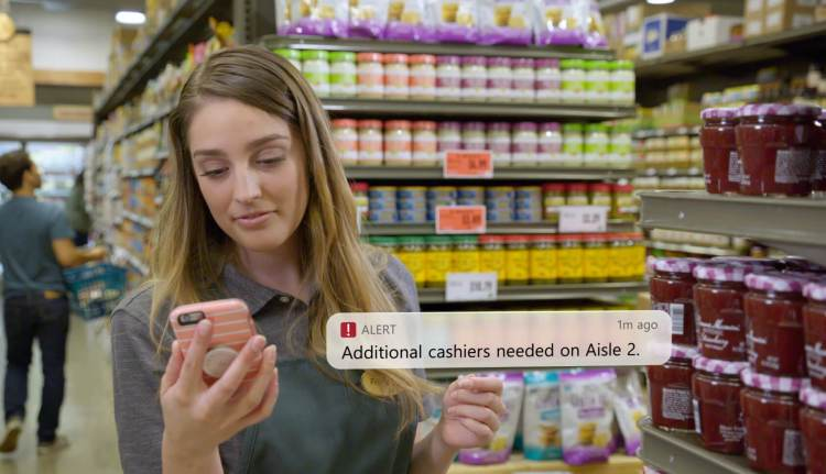 A store clerk responds to an alert from Microsoft Dynamics 365