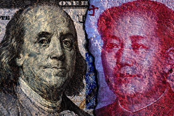 Closeup of cracked of Face to face of US dollar banknote and China Yuan banknote for 2 biggest economic in the world which now United states of America and China have war trade.Both countries conflict