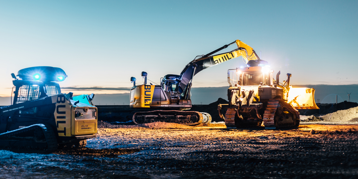 Built Robotics excavator and dozer on a construction site
