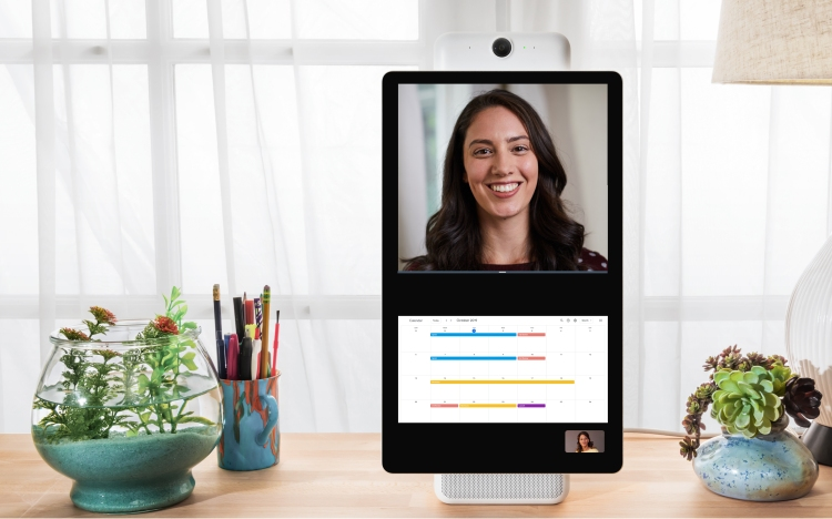 A Workplace video call with Portal+ uses split screen for a calendar below and image of the call above.