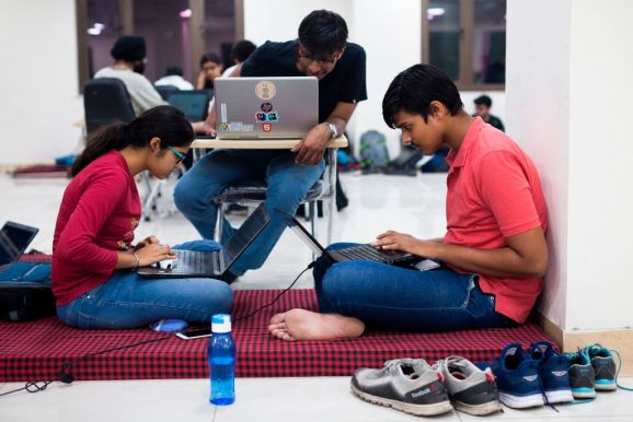 In this picture taken on October 27, 2018, Indian undergraduate students work in their project teams as they take part in HackCBS, a 24 hour hackathon at SSCBS in New Delhi. (Photo by XAVIER GALIANA / AFP)