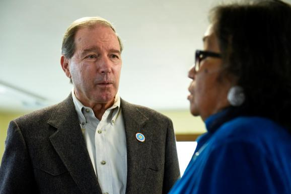 FILE PHOTO: U.S. Sen. Tom Udall (D-NM), visits with Phyliss Young, an organizer of the tribal get-out-the-vote coalition ahead of the 2018 mid-term elections on the Standing Rock Reservation in Fort Yates, North Dakota, U.S. October 26, 2018.