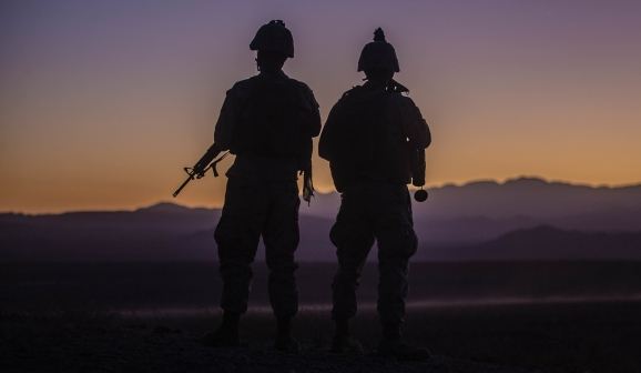 U.S. Marine Corps Staff Sgt. William Huffman, left and Cpl. Stephen Gibbons with Combat Logistics Battalion 8, Combat Logistics Regiment 2, 2nd Marine Logistics Group, prepare to depart an observation point during Integrated Training Exercise (ITX) 1-20 at Marine Air Ground Combat Center Twentynine Palms, California, Oct. 28, 2019. CLB-8 integrated with 3rd Marine Regiment during ITX as the logistics combat element to provided tactical logistics in the areas of medium and heavy-lift motor transportation beyond the regiment's organic capabilities. (U.S. Marine Corps photo by Cpl. Scott Jenkins)