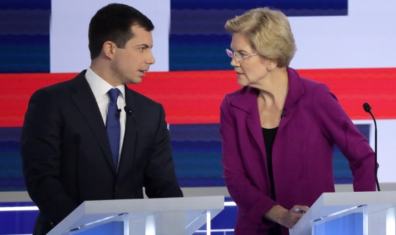South Bend, Indiana Mayor Pete Buttigieg and Sen. Elizabeth Warren (D-MA) speak during the Democratic Presidential Debate at Tyler Perry Studios November 20, 2019 in Atlanta, Georgia. Ten Democratic presidential hopefuls were chosen from the larger field of candidates to participate in the debate hosted by MSNBC and The Washington Post.